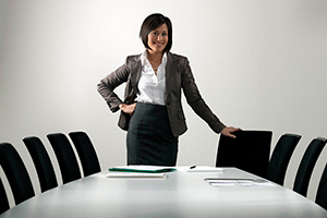 Exec-Woman-By-Board-Table