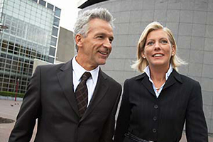 Executives-man-and-woman-walking